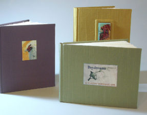 Examples of the Simple Round Back Spine structure with cloth covered boards and recessed labels. (The book in the back has a raised label effect we will discuss.)