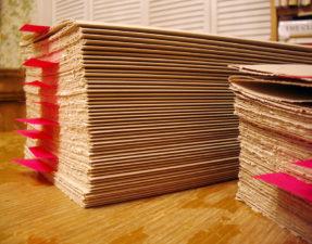 Stacks of Zerkall Nideggen awaiting binding into visual journals.