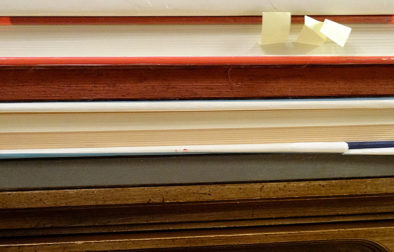 All my binding methods can be done at home without any special equipment. I stack my books with heavy art books as weights, there are also some bricks on the top of the stack that didn't make it into the photo. When I'm done binding everything gets put back on the shelves and it's life as normal.